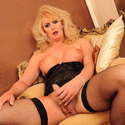 Sexy alison dale strokes her uncut cock.