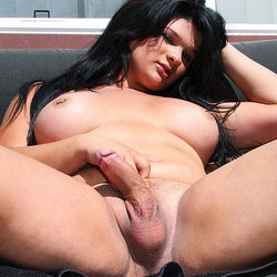 Thick tranny brittney strokes her cock outdoors.
