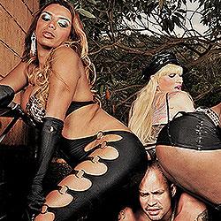 Three tranny dommes gangbang a slave.