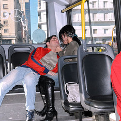 Slutty shemale drops to her knees and sucks cock on crowded bus.