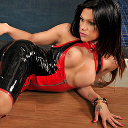 Young tgirl is sexy in latex.